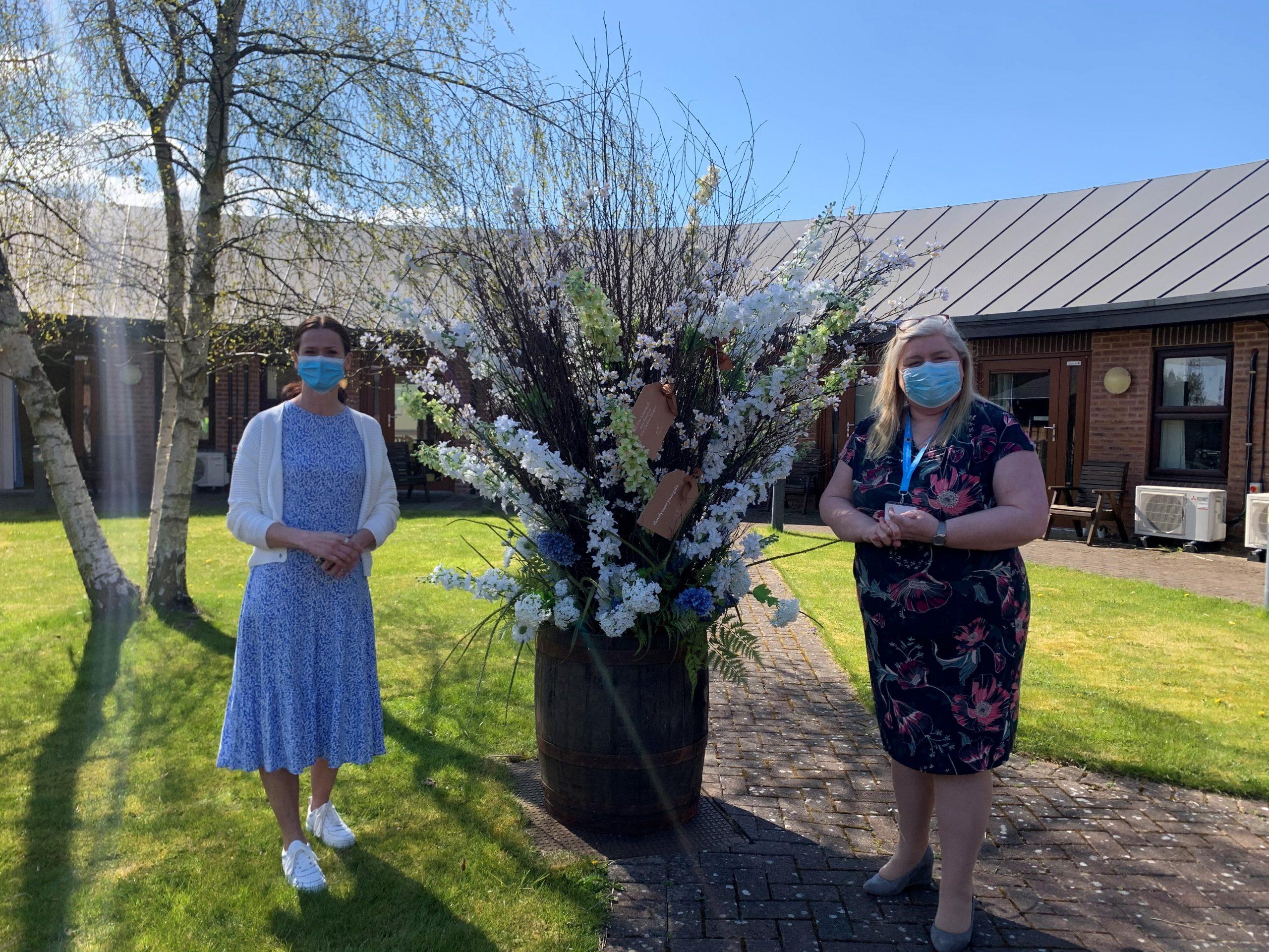 Neptune Shop Donates Flower Display